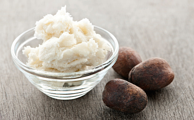 Shea butter and nuts in bowl
